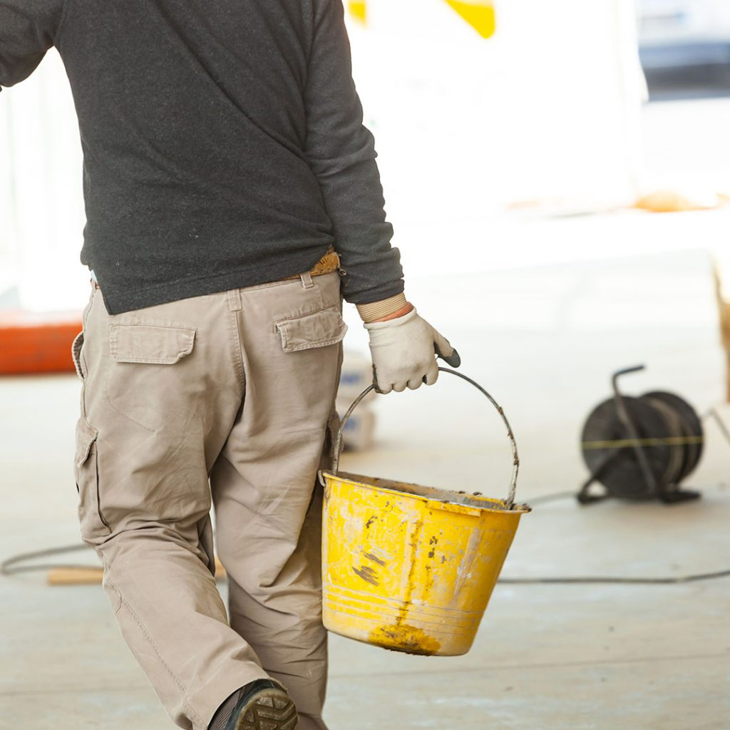Construction worker with cement.